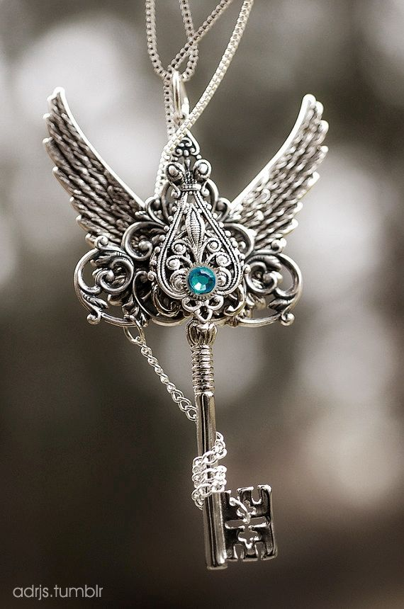 Arch angel Wings with a Gem on the top of a key = key to my heart ;) maybe rather than sword.....