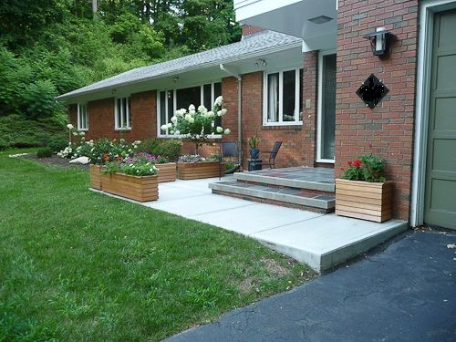 Midcentury modern porch entry w/ multi colored slate tile landing & step.