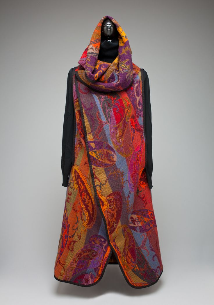 Long Vest Coat.  Fully reversible.  Many different colors and patterns.  Hood can be worn as a hood or a collar.