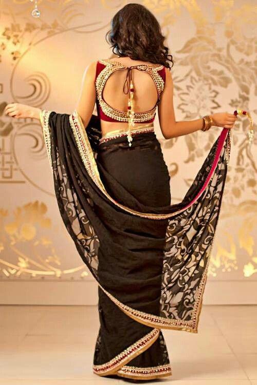 Beautiful saree choli blouse in red and gold with saree in black and gold with a touch of red, via @sunjayjk