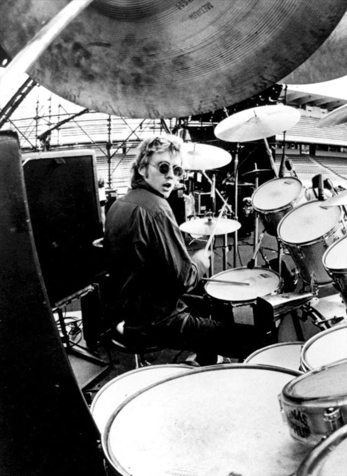 Roger Taylor - The greatest drummer of all ? Not a bad voice either.......
