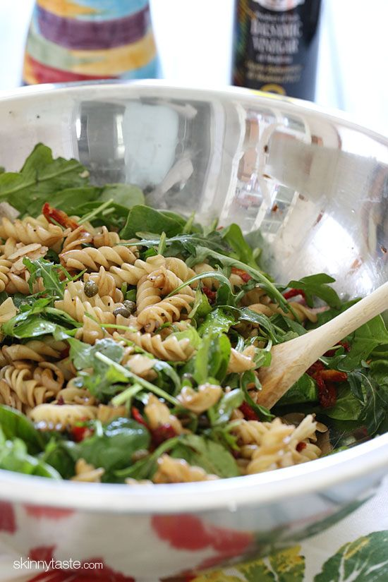Summer Pasta Salad--baby greens, sun-dried tomatoes, capers, freshly shaved parmesan cheese (makes a huge difference), balsamic vinegar, and olive oil.