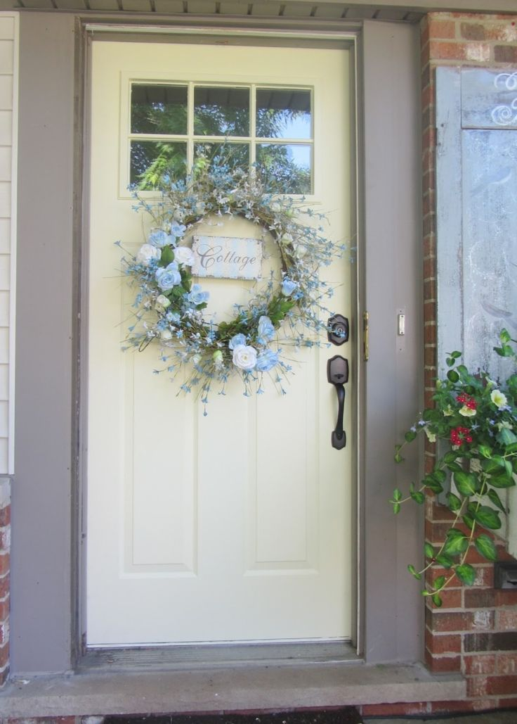 Exterior. Blue Flower Door Wreath Adhered On White Painted Front Door Using  Oil Rubbed Bronze