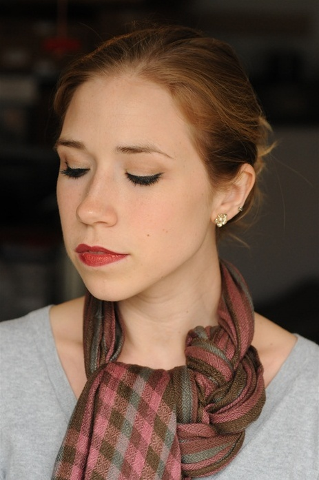 Mer says: This is really easy and a absolutely gorgeous. I have a paisley-on-one-side-and-mustard-on-the-other scarf that really shows off the tying patter. It's easier with a longer scarf. Also gorgeous with a pin. *** lovely scarf tying tutorial!