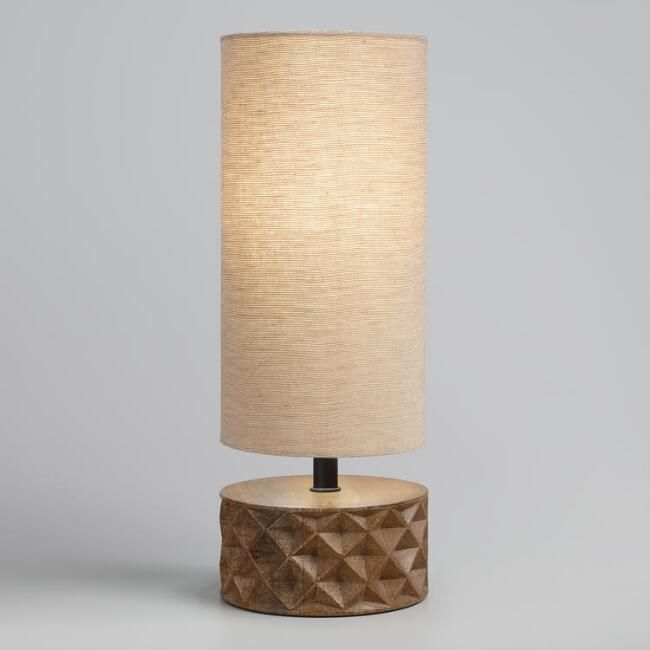 Pairing A Hand Carved Faceted Mango Wood Base With A Tall Tan Cylindrical Linen Shade Our Exclusive Table Lamp Features A Sop Table Lamp Wood Lamp Table Lamp
