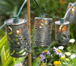 Recycled soup cans; an inspired artist and get eco friendly garden illumination idea.