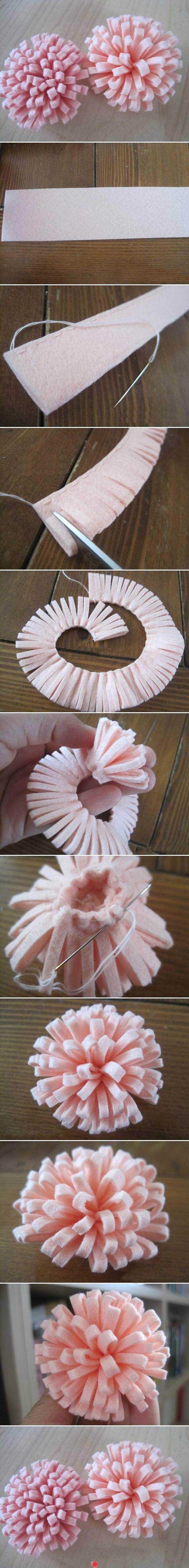 Pretty fringe-cut rolled felt flower. Idea - use crepe or plain paper to make similar paper flower! :)