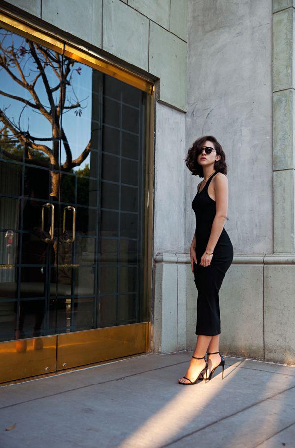 Wearing Saint Laurent shoes, vintage gold chains, and Super sunglasses.
