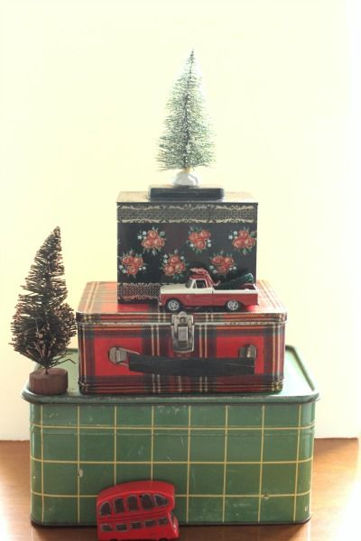 Christmas home tour - love this cute little stack of metal boxes!