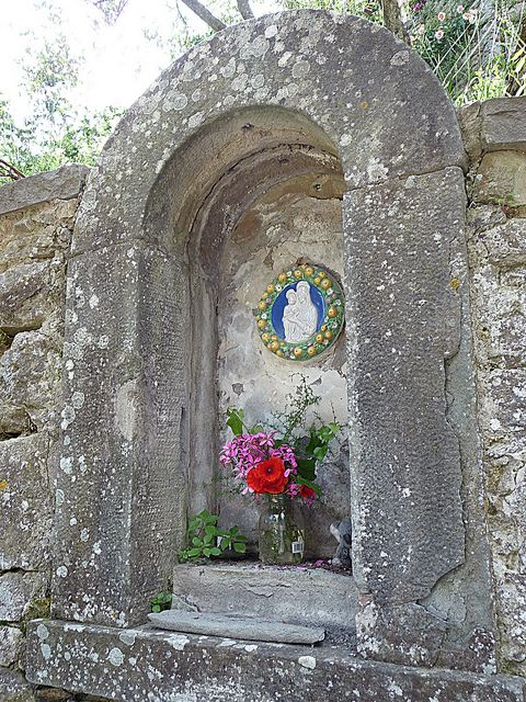 Throughout Italy you can find shrines like these in all sorts of places, from fish markets to stone walls such as this one in Cortona, Tuscany, Italia.