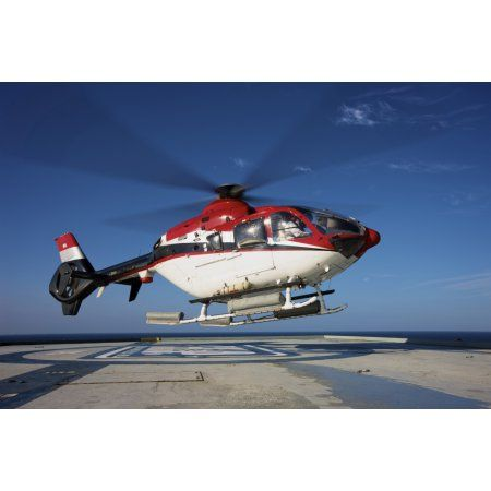 Eurocopter EC135 utility helicopter on the helipad of an oil rig Canvas Art - Terry MooreStocktrek Images (35 x 24)