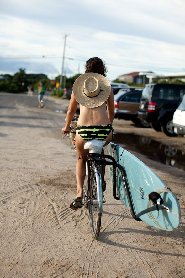 I want to be this gal on a beach in a bikini with a surfboard strapped to my bike...not in snowy NYC...via the Sartorialist