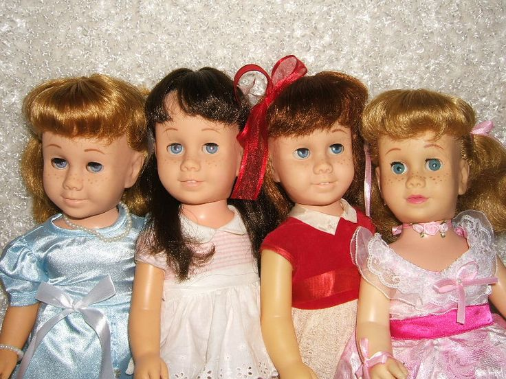 Chatty Cathy Doll Pictures - my Chatty Cathy was the third from the left (red/white dress and red hair)
