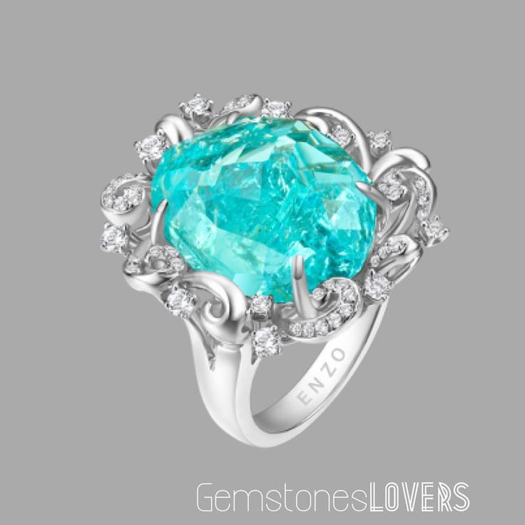 Enzo Jewelry White Gold Paraiba Tourmaline and Diamonds ring. ⠀⠀ ⠀⠀⠀⠀