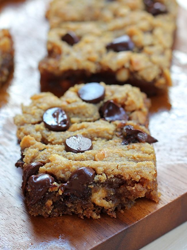 GOOEY CHOCOLATE CHIP PEANUT BUTTER BARS - dangerously addictive... like the lovechild of a chocolate chip cookie and a Reeses peanut butter cup! Full recipe here: http://chocolatecoveredkatie.com/2015/03/18/chocolate-chip-peanut-butter-bars/