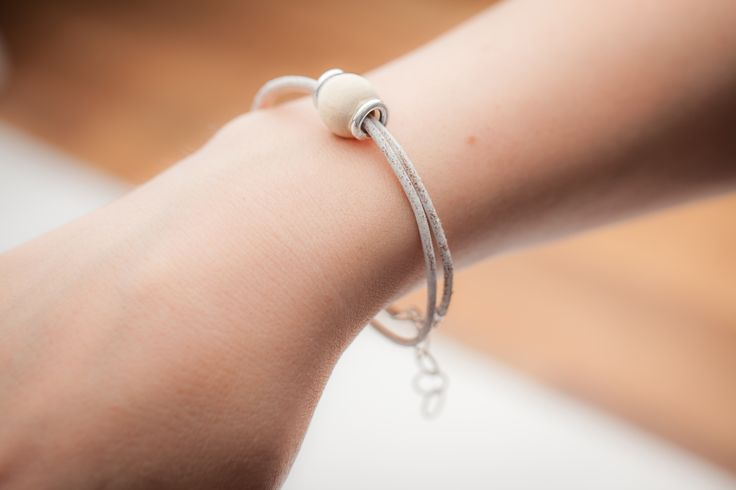 """Our hand-made jewellery are the """"Symbol of Life""""  Our Bracelets, Rings, Earrings and  Necklaces are made of realy soft leather, sterling silver, and a pure, natural wooden part from the same year when you or your loved ones were born. That makes our jewellery your own unique timeless memory. #bestgiftidea #giftidea #woodenbracelet #bracelet #jewel #jewelry #jewellery #birthday #forher #forhim #woodenbeads  https://www.etsy.com/uk/shop/MsHeartwoodJewellery"""