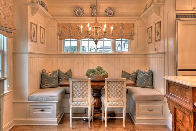 Oh, this kitchen eating area is perfect. Love the banquette, the chairs, the window treatment, pillows, chandelier, etc. Also love the plate rail.