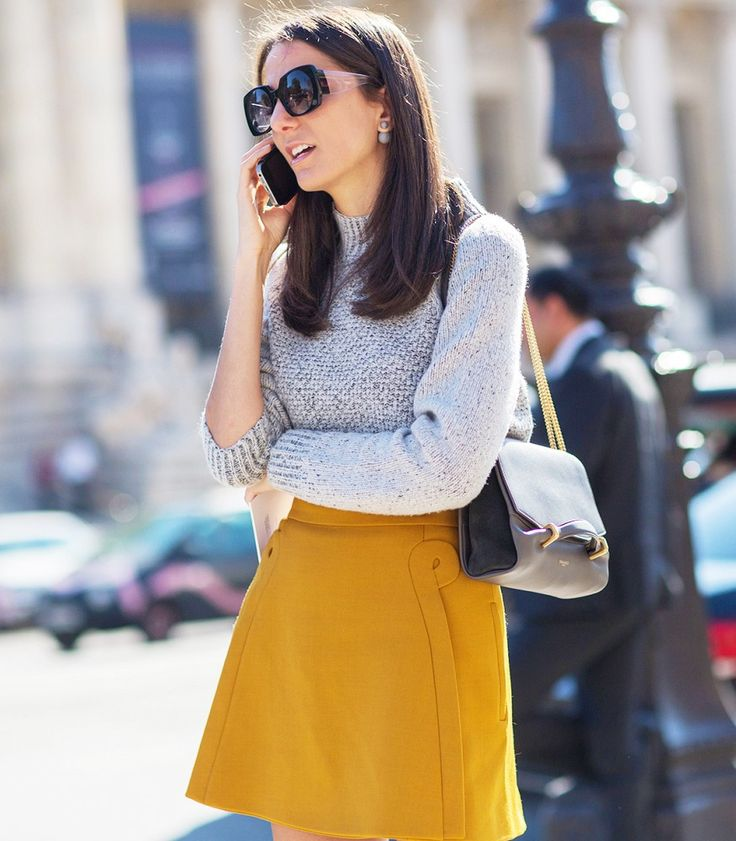 Pair a mustard yellow skirt with a light knit for a quick chic look. // Photo: The Styleograph #Streetstyle #PFW