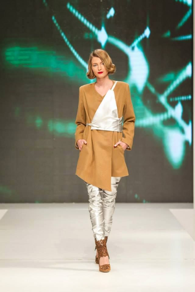 "Look #5 from our FW15 collection ""SandStorm"" presented at Band of Creators fashion show. If you like this look, you can find it online and on demand! For every purchase, you get a makeup bag! Outfit beautifully worn by Arz Karin , comprised of the #ElectricCharge #silverleggings, #DesertRebel #camelcoat and accessorised with the #SilverShield! Shoes by Bianca Georgescu. #starwars #inspiration #fw15"