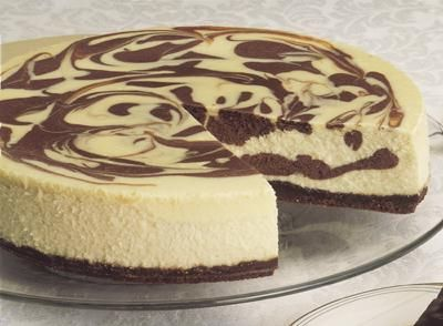 View this delicious and easy Summer inspired Deluxe Marbled Cheesecake from Celebrate with Hershey's.