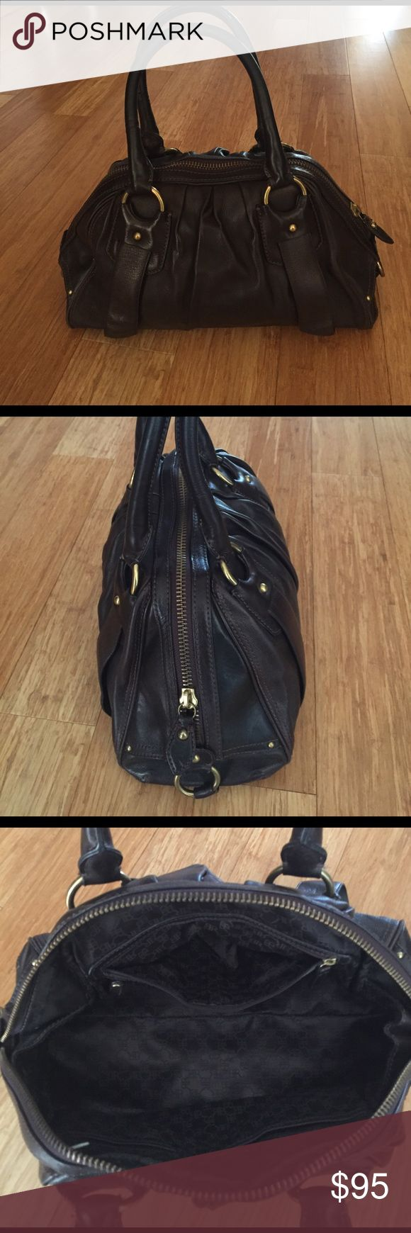 Banana Republic leather handbag This beautiful Banana Republic handbag is made of luxurious high quality dark chocolate leather with bronze hardware. In amazing condition this will be a perfect addition to your collection! Banana Republic Bags