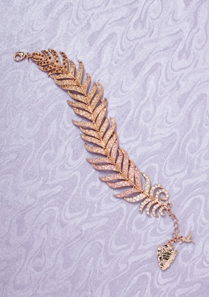 DISNEY COUTURE Pocahontas Feather Bracelet. I NEED THIS