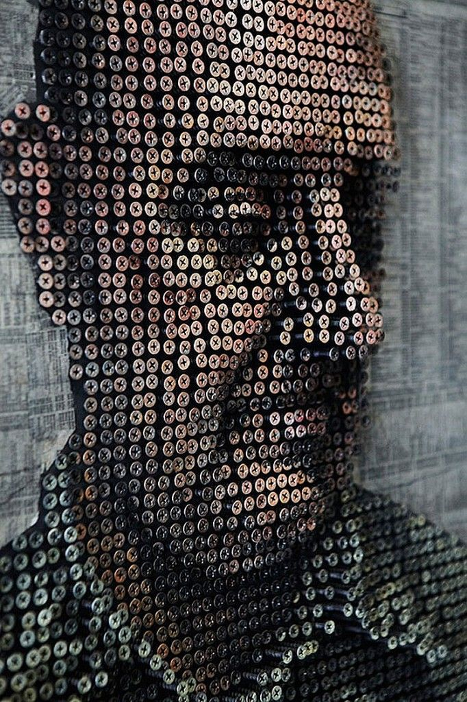this is a 3-D portrait made out of screws that this artist (Andrew Myers) painted.