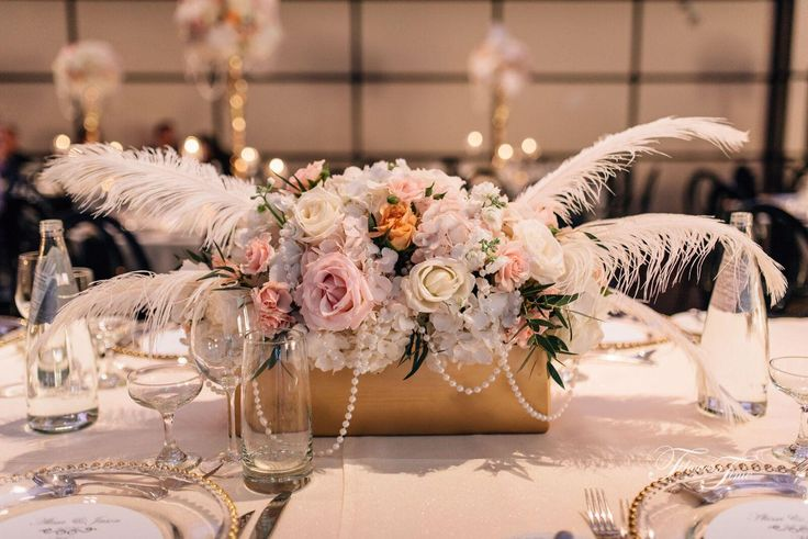 Gatsby style wedding centerpiece feather pink roses hydrangea