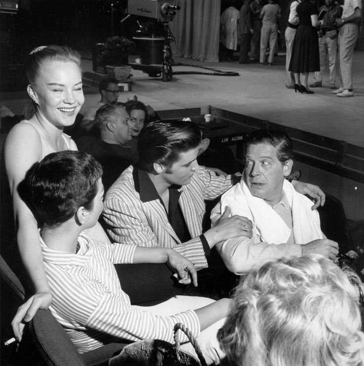 """The ORIGINAL: Elvis and host Milton Berle during the rehearsals for the """"Milton Berle Show"""" in Los Angeles, CA. The guests on Berle's show attended several days of rehearsals in preparation for the live broadcast on June 5, 1956 but Elvis was unable to attend the first day because he was performing two shows in Oakland, CA on June 3, 1956."""