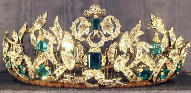 The parure was made by C.M. Weissshaupt in 1840.  It uses 26 emeralds King Christian VI gave to Queen Sophie Magdalene in 1723 and 41 emeralds that belonged to Princess Charlotte of Denmark.  This tiara is part of the Danish Crown Jewels so it cannot be taken outside of Denmark or be worn by anyone other than the queen.