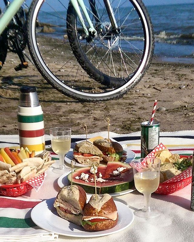 My wife and I decided to go for a picnic this afternoon. So, I raided the fridge, grabbed a bottle of wine, threw on the picnic knapsack, we hopped on the bikes and headed to the beach... Some leftover dips, pita, carrots, # with feta and pretzel bun sandwiches with oven roasted turkey, lettuce, brie and mustard of course. Other than a few ants, it was a perfect picnic! @zimmysnook