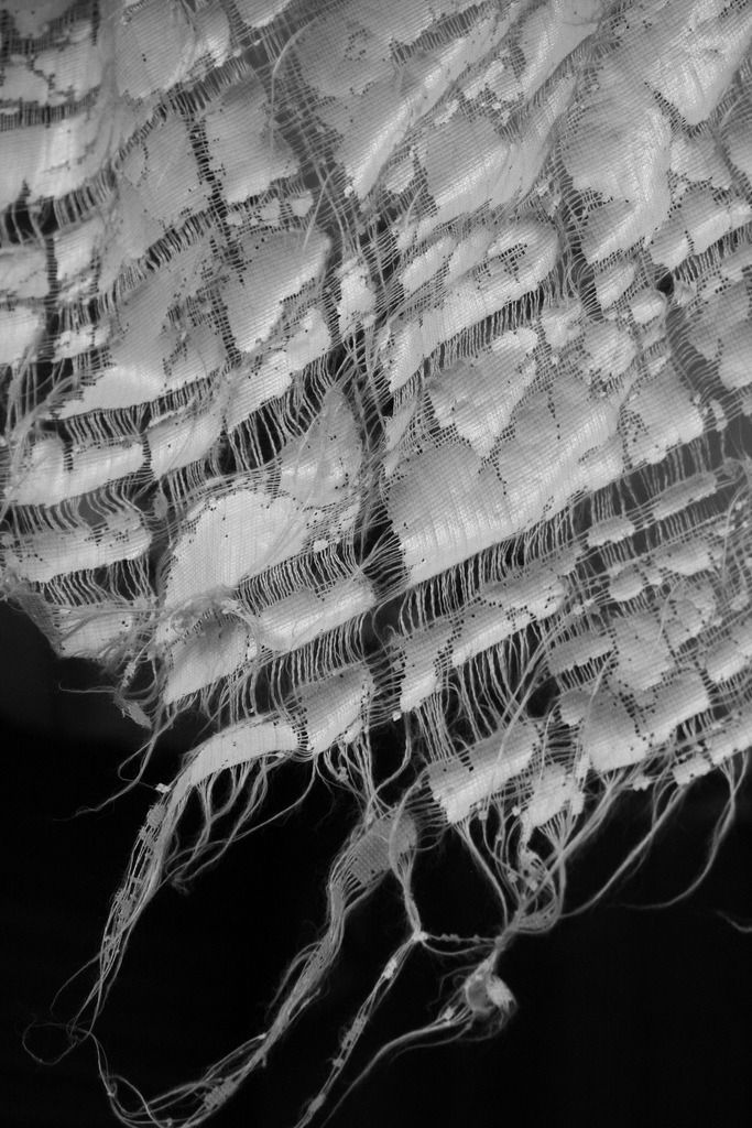 Distressed Textiles Design - woven fabric detail with disheveled white textures; fabric manipulation; experimental weaving