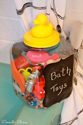 DIY Bath Toy Tub using an old plastic tub, rubber ducky, spray paint, and chalkboard vinyl. Organize kids small bath toys!