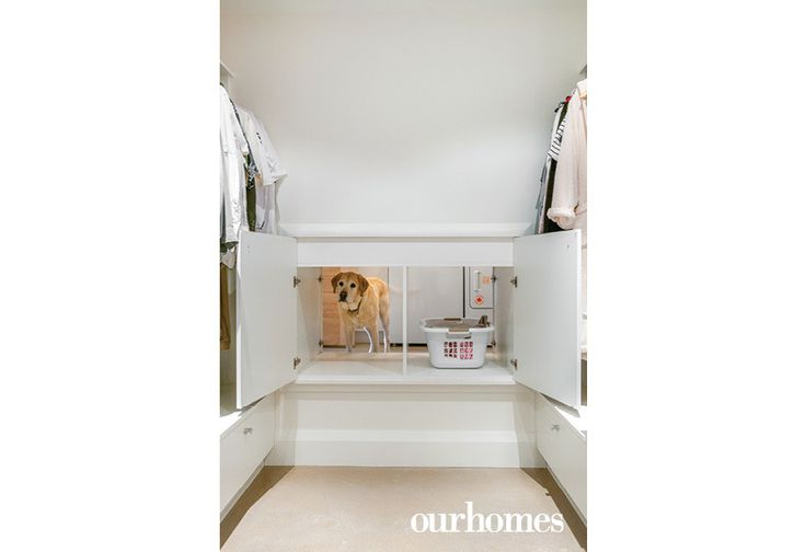 "Cabinets inside the laundry room connect to a pass-through from the master bedroom's large walk-in closet. Laundry and curious pets are easily transferred from one space to the other.     See more of this home in ""3 Hard-Working Mudrooms Share Tips and Tricks"" from OUR HOMES Southern Georgian Bay Ski Season 2017    http://www.ourhomes.ca/articles/build/article/3-hardworking-mudrooms-share-tips-and-tricks"
