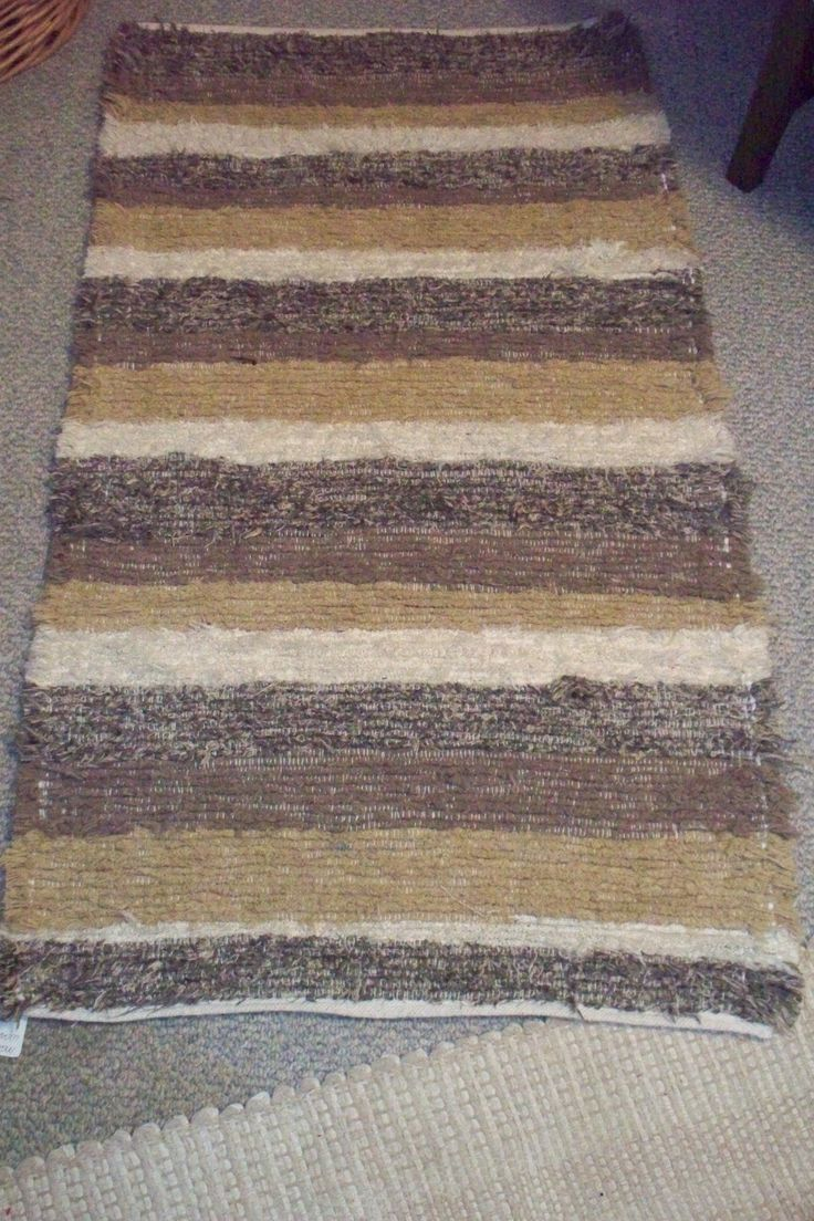 Handmade Artisan Woven Rug 28 X 49. This rug is woven in my Michigan studio. It is made of upholstery fabric selvedges from the furniture mills down south. This rug is a variety of taupe, white, muted greens and beige. They are very durable as they are the same material as couchs and chairs are covered with. Machine wash and dry. They are quite thick, may not work in front of a door. Great for any floor, wood, tile, or on carpet. Great for living room, den, kitchen, bath. They feel…