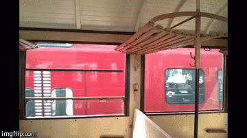Modern double decker train crossing our nostalgic steam train.