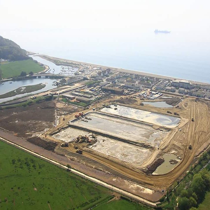 How would you raise this entire site by 2 metres? In 2011 we provided a ground investigation in Seaton Devon for a new housing development and Tesco superstore. To comply with flood risk assessments the entire site had to be raised by around 2 metres - requiring 300000m of fill material.  To avoid disruption on the roads we brought this in by barges and a temporary pipeline. Not only did this cause minimal disruption to local residents it had cost and environmental benefits for the client…