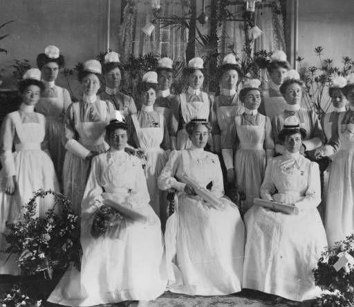 St Paul Training School for Nurses, first three graduates with student nurses 1900