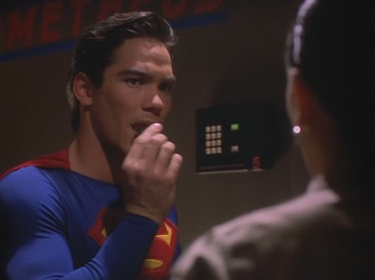 """By WB, Siegel & Shuster's Superman (Dean Cain) eating a bomb in front of a horrified Lois Lane (Teri Hatcher) in season 1 of """"Lois & Clark: The New Adventures of Superman"""" (1993-1997)"""