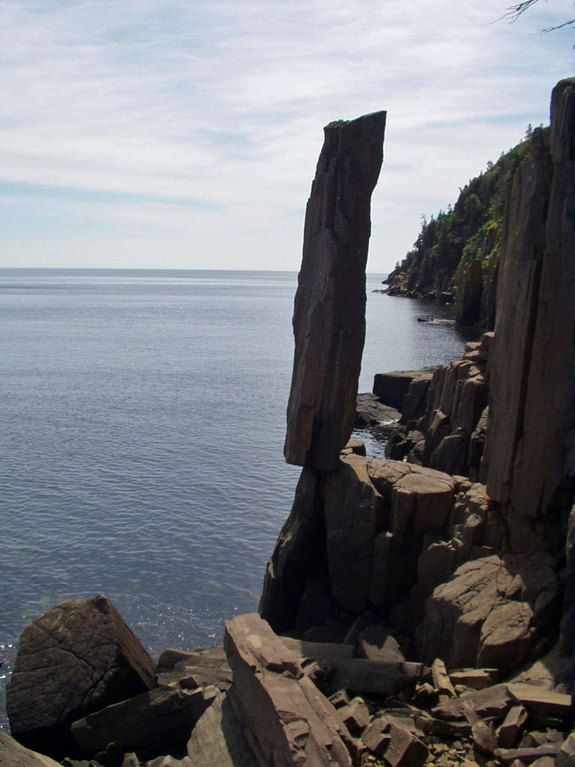"""This strange """"basalt stack"""" balances precariously over the water near Digby, Nova Scotia, in Canada."""
