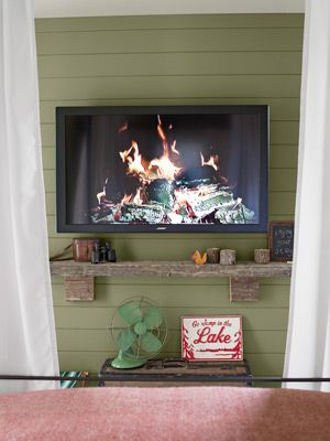 Country Living - 2012 House of the Year: Guest Bedroom Cottage > Thomas mounted this flatscreen on a rustic green wall and added outdoor charm to keep it all within his Camp theme.
