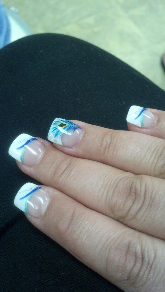 I am not sure if I would want to go this far with the detailing but I like the idea of having a bit of our wedding colors on my nails too.