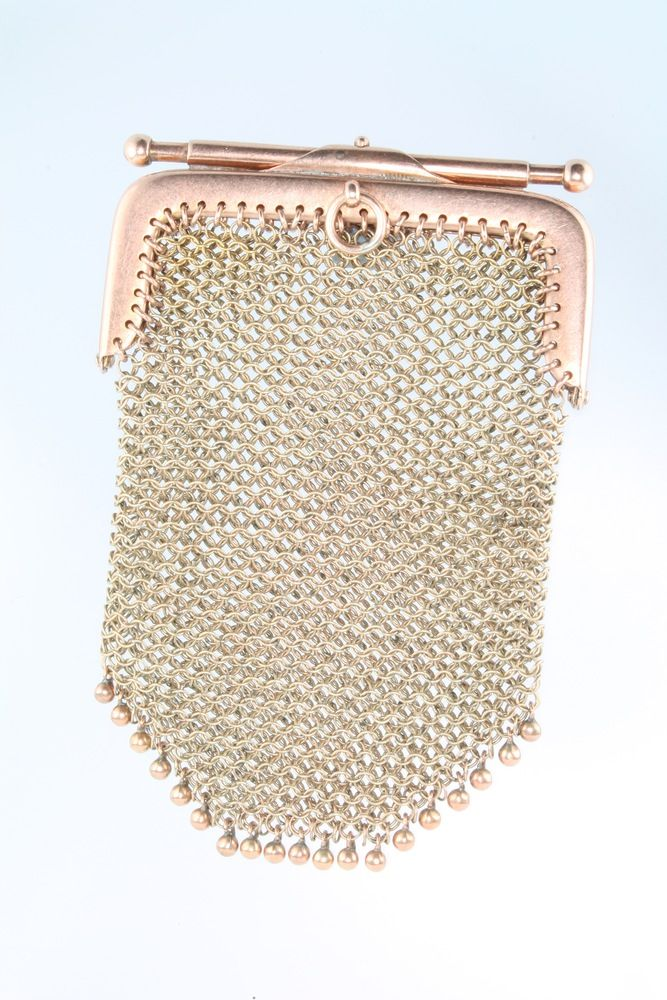 LOT 686, A 9ct yellow gold mesh purse, 28 grams SOLD £260