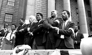 James Baldwin (right) joins civil rights leaders in New York, September 1963, to pay tribute to the four girls killed in the Birmingham, Alabama, bombing.