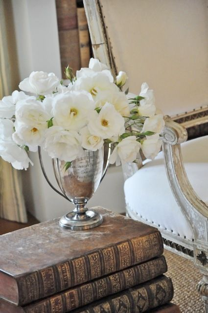 Inspiration for mantle- Collection of old silver pieces filled with flowers.