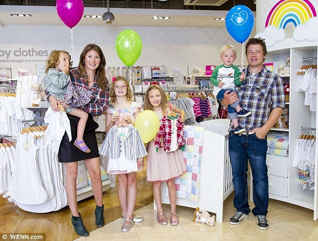 Big hit: Jools Oliver pictured at the launch of her Little Birds collection with children, from left, Petal Blossom Rainbow, Poppy Honey Rosie, Daisy Boo Pamela and Buddy Bear Maurice Oliver