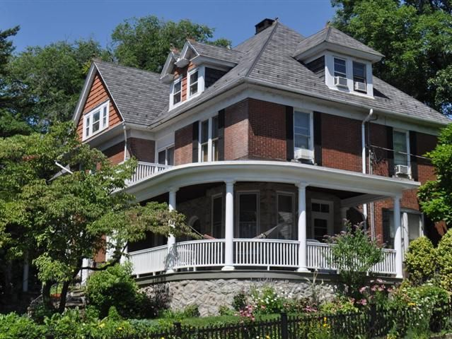 Exquisite and Stately 3100 Sq Ft Stone and Brick College Hill Victorian with all the charm and character of yesteryear combined with the amenities of today setting majestically on a beautiful landscaped corner lot. Enter this 5 BR 2.5 Bath Classic from the wide wrap-around front porch into another era. The first floor features 10 ft ceilings a wood-burning fireplace in the foyer gorgeous open staircase restored living and dining rooms a gorgeous custom kitchen and breakfast area with access…