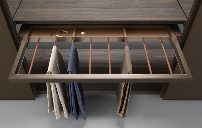 Trousers rack with belts tray in castoro regenerated leather finishing.