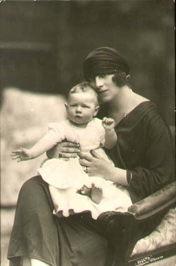 "Baby Prince Michael with his mother, Crown Princess Helen. Helen never became Queen of Romania as she was divorced from Carol before he became king. After her divorce the Romanian gov't gave her the title ""Princess of Romania"". And after Michael reascended the throne in 1940 he made his mother ""Regina Mama"", Queen Mother of Romania."