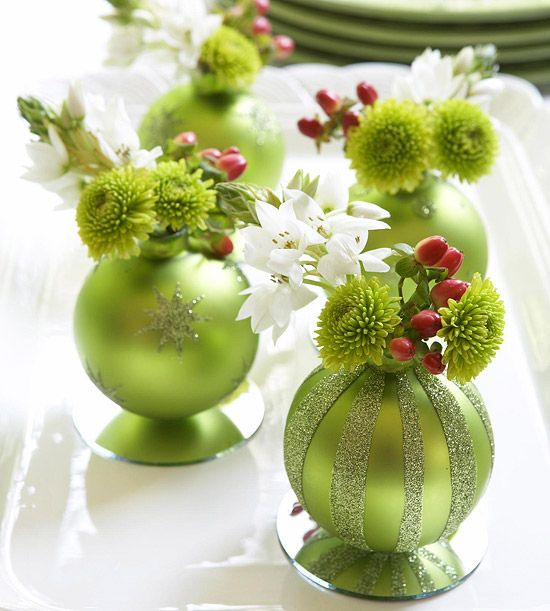Add color and sparkle to your table with an ornament centerpiece guaranteed to wow friends and family. Start by decorating plain ornaments with glitter and glue. Draw designs (stripes, stars, etc.) on the ornaments with crafts glue and sprinkle with glitter. Tap off excess glitter and let dry. Glue the embellished ornaments to mirrored discs (available at crafts stores). Remove the ornament hangers, pour a little water in the ornament and insert flowers and berries.